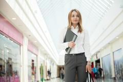 Young office woman with document folder - stock photo