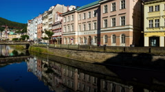 Karlovy Vary (Carlsbad) Czech Republic. Reflection in river water. Timelapse Stock Footage