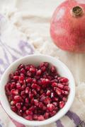 Close up of pomegranate and seeds - stock photo