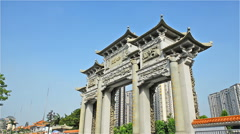 Chinese archway with stone carving zooming in Stock Footage