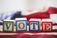 Close up of vote toy blocks on American flag Stock Photos