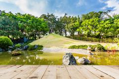 Wood floor on Pond and Water Landscape in Japanese Garden Stock Photos