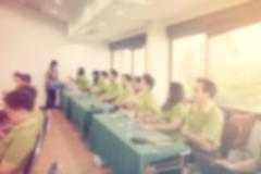 Abstract blurred people in seminar room with vintage effect. Stock Photos