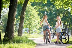 Teens on bicycles - stock photo