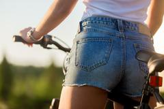 Sexy young biker woman Stock Photos