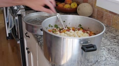 Couple making homemade peach salsa in kitchen Stock Footage