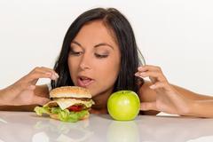 choosing between hamburger and apple - stock photo