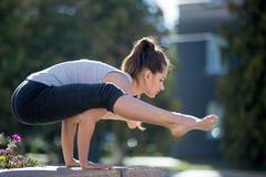 Street yoga: Firefly asana Stock Photos