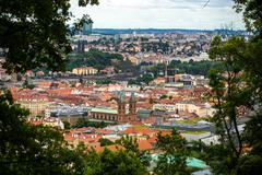 Stock Photo of Prague from above in frame of greenery