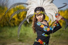 Stock Photo of Native American woman in traditional headdress performing ceremony