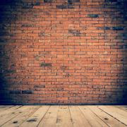 old room interior and brick wall with wood floor, vintage background - stock photo