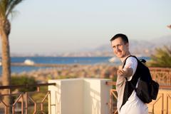 Follow me at sea resort - stock photo