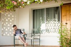 Young man sleeping on veranda Stock Photos