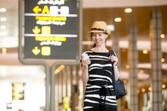 Woman using mobile phone in airport Stock Photos