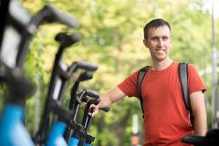 Young man renting bike - stock photo