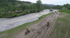 A river and KTM motorcyclists passing by Stock Footage