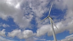 Stock Video Footage of Wind Generator with blue sky and moving clouds