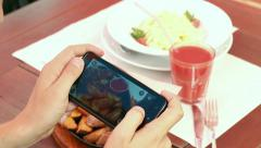 Cook photographs cooked culinary dish on the phone - stock footage