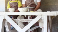 Stock Video Footage of Master with apprentice potter's wheel spins feet