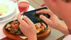 Take a photo of food in a restaurant with mobile phone camera for social network Stock Footage