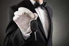 Close-up Of Waiter Holding Car Key In Hands - stock photo