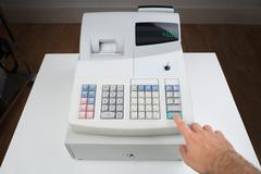 Close-up Of Person Hands Entering Amount On Cash Register Kuvituskuvat