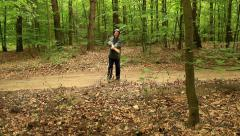Crazy axe woman brandishing an axe in the air Stock Footage