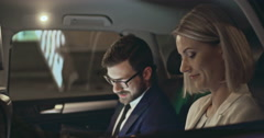 Business Talk in Back Seat Stock Footage