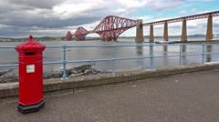 Historic red Forth Bridge in Edinburgh - Scotland - time lapse Stock Footage