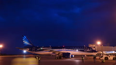 Photographers in the night at the plane spotting, timelapse Stock Footage