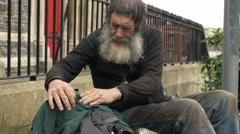 old man homeless sleeping in the street: elderly poor man - stock footage