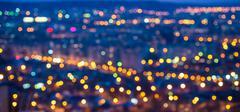 Abstract circular bokeh city lights colorful background, panorama Stock Photos