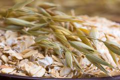 rolled oats and oat stalks - stock photo