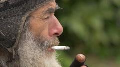 Sad old man smoking in the city  Stock Footage