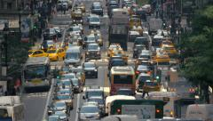 NYC rush hour busy congested street traffic jammed cars New York City wide day - stock footage