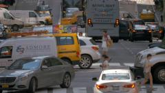 Stock Video Footage of Rush hour busy street traffic intersection cars pedestrians NYC New York City
