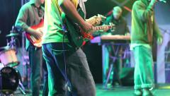 Stock Video Footage of Close up of a guitarist on the scene of reggae concert