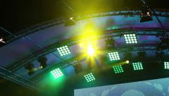 Concert lights on stage - and strobe lights flashing in the rain - stock footage
