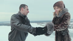 Couple throw out snow heart Stock Footage