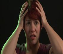 Caucasian Red-Head Expresses Frustration and Runs Hands Through Hair - studio Stock Footage