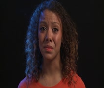 Mixed Race Woman is about to cry in close up, black background - stock footage