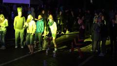 Stock Video Footage of People dancing in the rain during a concert reggae feel freedom