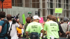 Security Detail at Global Warming Protest Stock Footage
