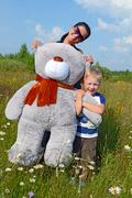 The girl with the boy holding Teddy bear - stock photo
