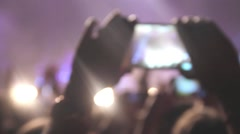 The girl at the rock concert recorded on a smartphone favorite artist Stock Footage