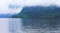 Video of Beautiful Lake Hallstatt in Austria cloudy fog over the mountain Stock Footage