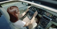 Sunroof shot of a young female driver Stock Footage