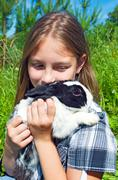 Portrait of the girl with the hare - stock photo
