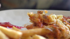 Eating a meal with french fries on plate 4k Stock Footage