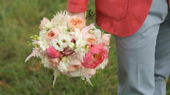 The Groom Holds A Bouquet - stock footage
